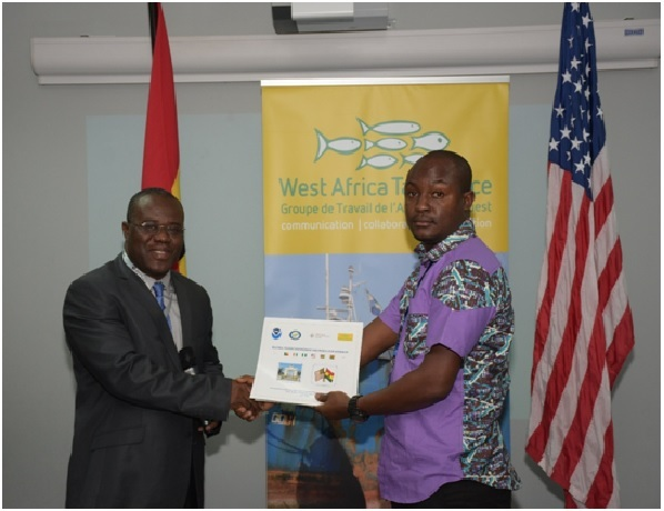 FCWC-Fish, WATF, NOAA meeting - The FCWC-FISH's General Secretary is handing a testimonial to a participant.