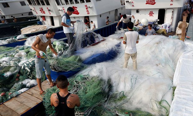 Fishermen arrange nets at the Qingkou port in east China's Jiangsu province. Photograph: Xinhua / Barcroft Images
