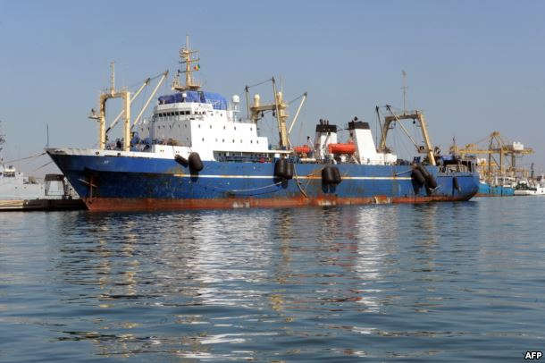 "FILE - A Russian trawler ""Oleg Naïdenov"", is moored in Dakar on Jan. 5, 2014. The ship was boarded after it was observed illegally fishing in Senegalese waters near the border with Guinea Bissau"