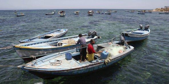 Des pêcheurs libiens dans le port de Sabrata. © Abdel Magid AI Fergany/AP/SIPA