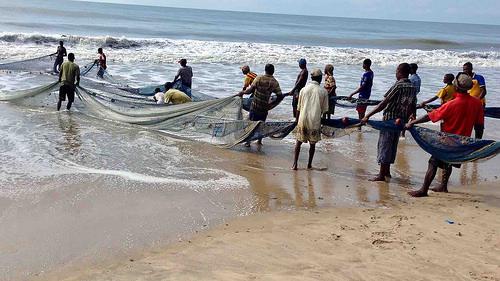 sea - fishermen pulling net