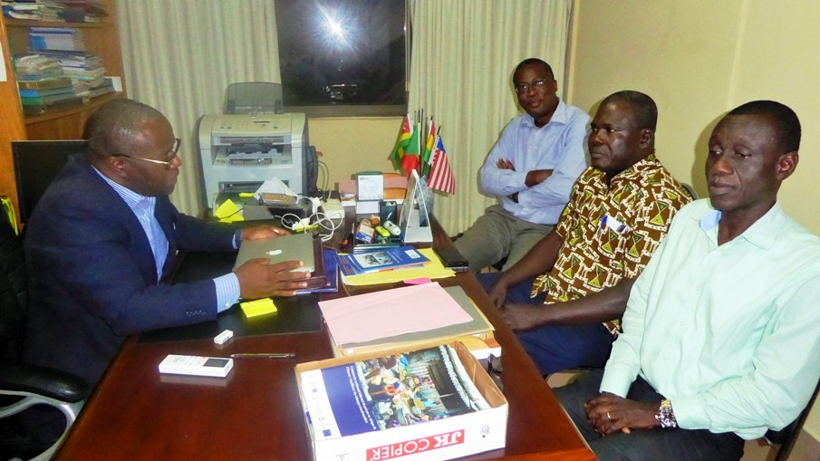 Photo - Mr Dedi holds discussions with the team in his office