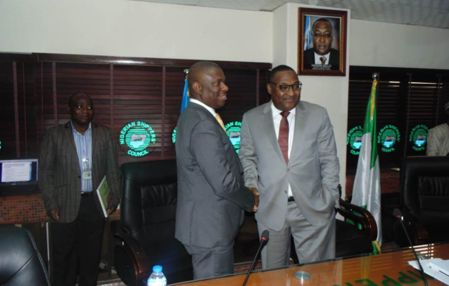 """L-R: The Director General, Nigerian Maritime Administration and Safety Agency (NIMASA), Dr. Dakuku Peterside in a handshake with the Executive Secretary, Nigerian Shippers' Council (NSC), Barrister Hassan Bello during a presentation on """"Introducing the Blue Sea Economy Concept"""" by the NIMASA DG to the Management of NSC in Lagos. Photo: NIMASA"""