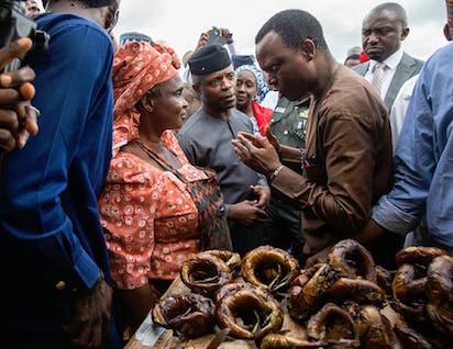 Osinbajo in Garki, Abuja market, interacting with traders