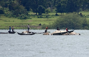 Uganda - Tanzania - River with fishermen on boat