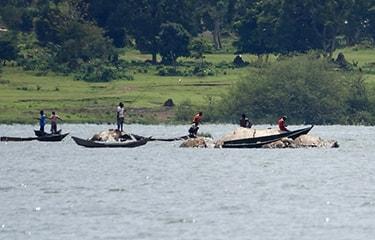 Uganda - Tanzania - River with fishermen on boat