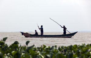 FILE PHOTO: Fishermen on a boat on the Lake Victoria. (Photo by Thomas Koehler/Photothek via Getty Images)
