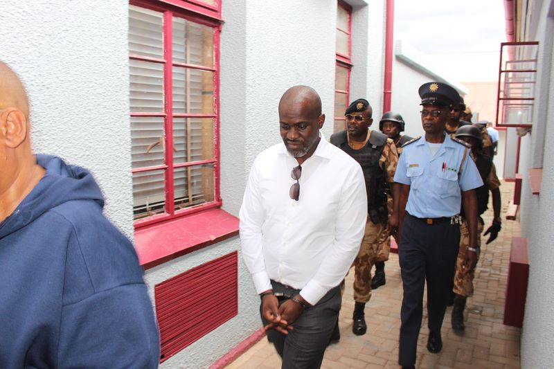 Former chairman of the board of Fishcor, James Hatuikulipi, being led into Windhoek Magistrate Court in February 2020. He and Sacky Shanghala are currently awaiting trial over revelations from the Fishrot bribery scandal, detailed below.